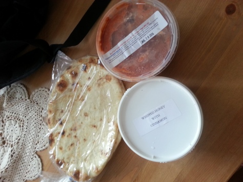 A modest market haul - naan, butter chicken curry, and honey.