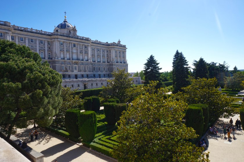 The Palacio Real and the Palace Gardens, with the spire of the cathedral in the background.