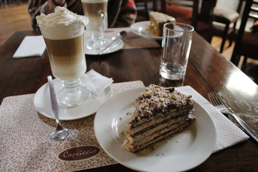 Delicious cappuccino and cake from Cafe Capriccio.