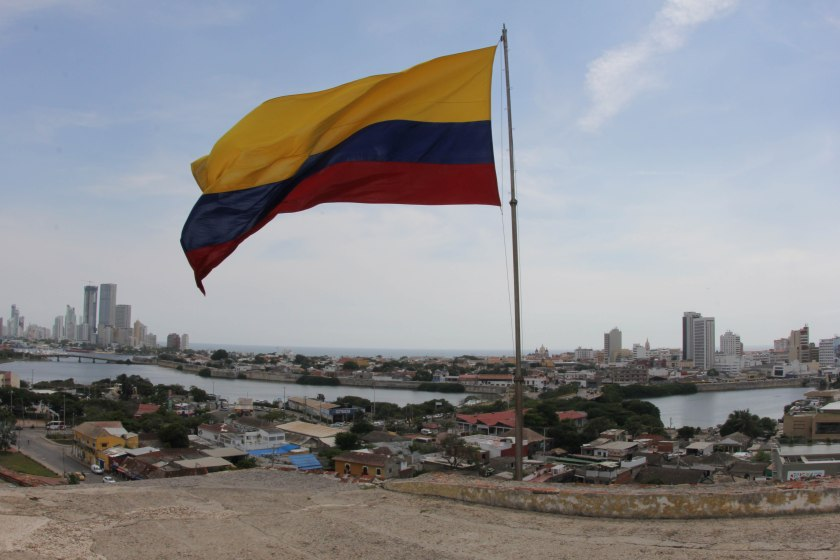 The Colombian flag on top of Castillo Felipe de Barajas, looming over the city. Yellow is for gold, blue for the two oceans, and red for blood.