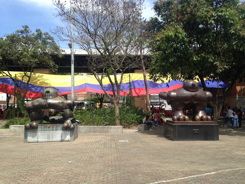 The bombed out bird sculpture by Botero on the left, his new, taller version on the right.